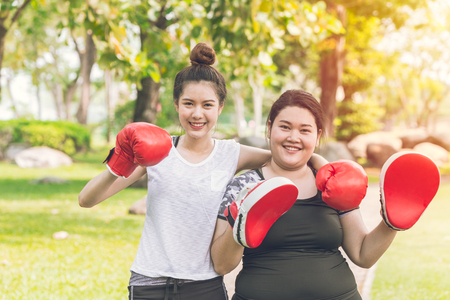 Two Friends boxing in the park for sport healthy activity and diet