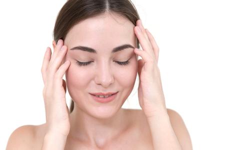 Beautiful women self head Temporal massage to pain relief headache