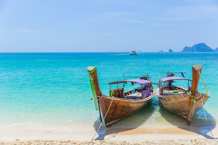 Thailand Andaman Sea Travel with Long tail boats on Tropical beach Summer Holiday