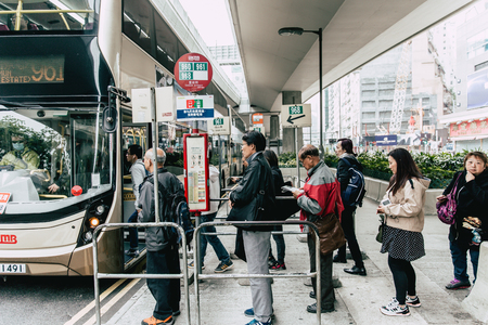 Public Bus station in Hong Kong with line queue of people waiting on the street most hongkong people use this bus service.Hong Kong.,24 November 2017.