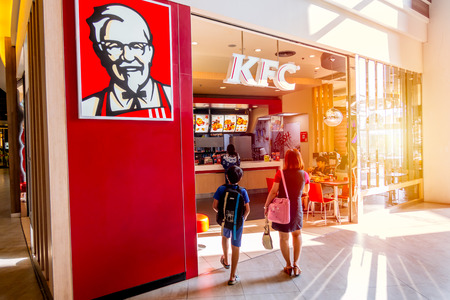 KFC (Kentucky Fried Chicken) shop in super market most popular fast food restaurant and a favorite of parents and kids for family eating together times.Bangkok.,Thailand 29 April 2018. Editoriali