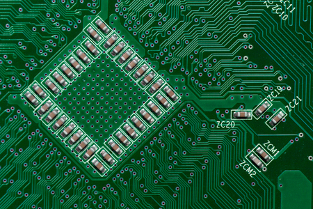 Ceramic Capacitors on Green Digital electronic circuit board texture pattern background