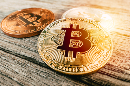 Bitcoin golden coin symbol of cryptocurrency digital money on wood background.