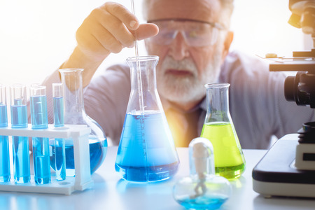 Chemistry professor scientist in science chemical lab to testing new medical formular Stock Photo