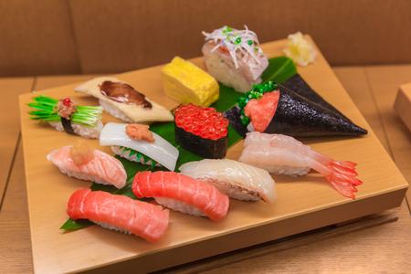 Sushi Mix Set fake of Japanese food on bamboo wood display sample in japan