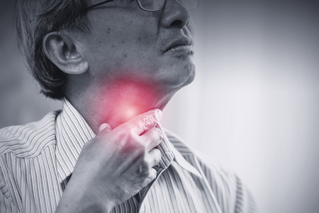 Asian elder old man Sore throat irritation and have a phlegm hand touching neck. Zdjęcie Seryjne - 105225508