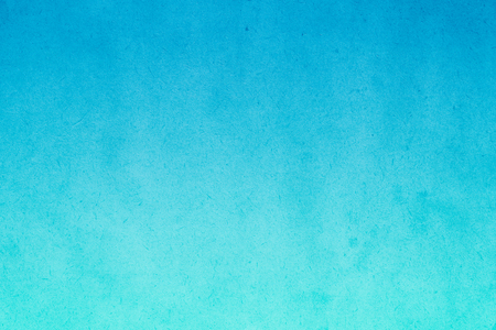 Blue gradient watercolor paint on old paper with grain smudge dirty texture abstract for