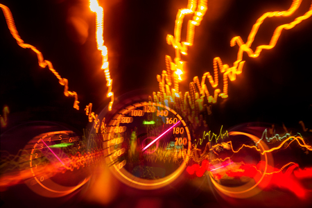 High speed road drive on night highway light trail with auto gauge speedometer blurry Stock Photo