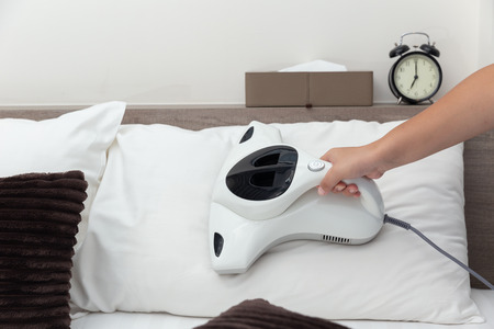 Mite vacuum cleaner using cleaning pillow bed mattress dust eliminator Stock Photo