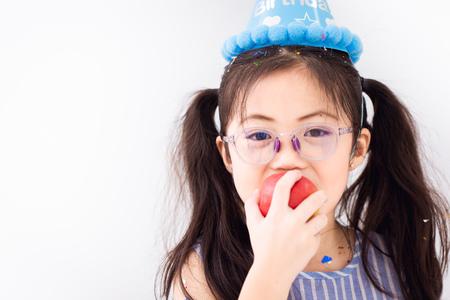 children glasses eating apple fruit on white copy space background