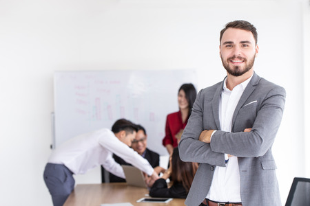 Businessman smile with employee working meeting teamwork office background. Stock Photo