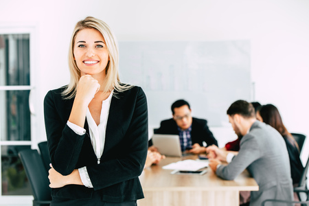 businesswoman manager standing smile with business team working together in office background. Stock Photo