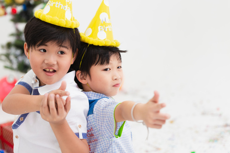 Two Asian kids child play together friend at party with white copy space, Stock Photo