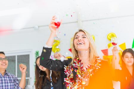 caucasian boss businesswomen dance in office party new year fun celebration. Stock Photo