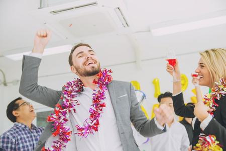 caucasian boss businessman dance in office party new year fun celebration.