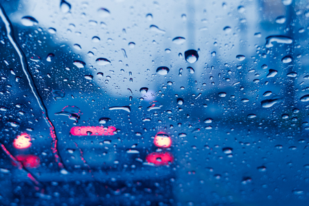 raining when driving a car on the road storm wet moist Banco de Imagens