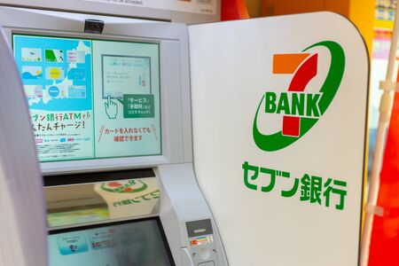 Seven Bank, Japanese bank by Seven & I Holdings ATMs money service installed at 7-Eleven stores in Japan, Osaka, 18 January 2019.