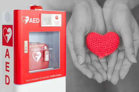 AED or Automated External Defibrillator first aid help giving life heart concept 免版税图像