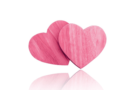 couple wooden pink heart isolated on white background