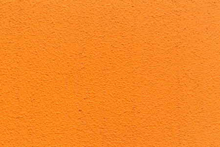 orange stucco wall texture pattern for background.