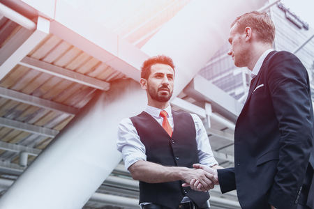 business deal concept, two businessman shake hands.