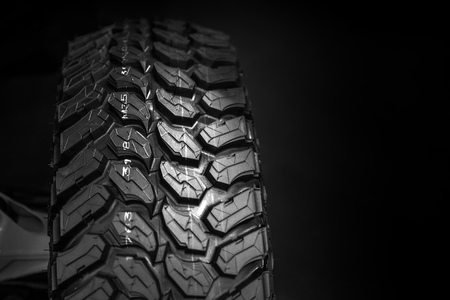 closeup new track off road tyre ATV mud tire with space for advertising background.