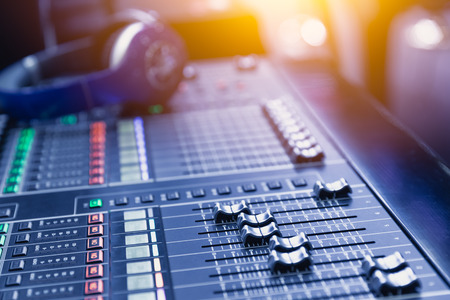 Music mixer sound recording engineer control desk for dj at stage show.