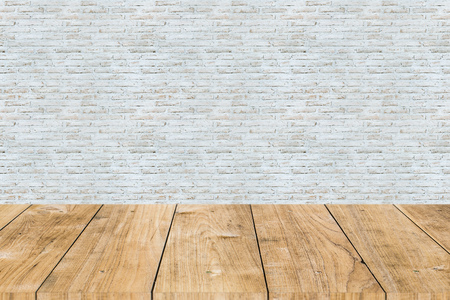 white paint brick wall with wooden table forground Stock Photo
