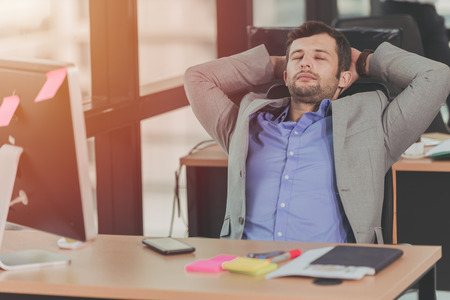 businessman relaxing rest nap after hard work day in the office Imagens