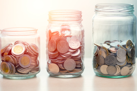 Personal financial or Saving Money concept, Coins collected in glass jar