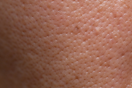 closeup male skin pores with face hire macro detail