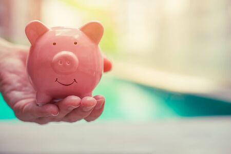 Pig Bank, Hand Holding, Personal finance money saving concept Standard-Bild