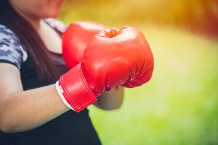 Girl wearing Boxing Gloves for fat fighting diet and healthy concept