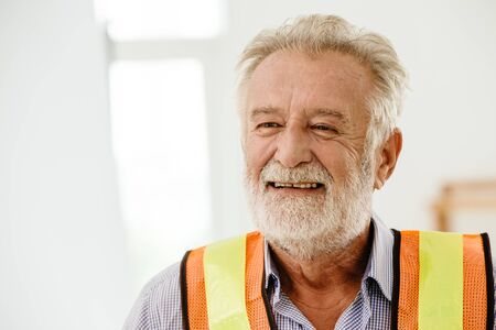 happy gentle smiling senior architect engineer portrait with space for text