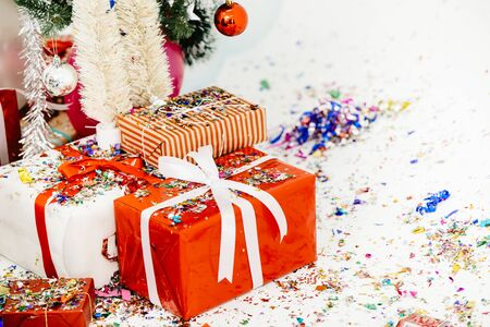Gift box with bow or Present in Christmas New year party decoration for background