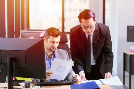 Businessman mix race help or working together in office