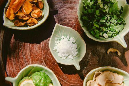 set of herbal spa treatments skin care salt bergamot sliced pandan leaf turmeric and curcumin