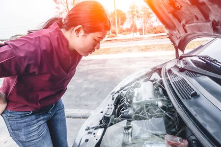 Girl car engine overheat brake down have a trouble alone at rode side. Stockfoto - 132014000