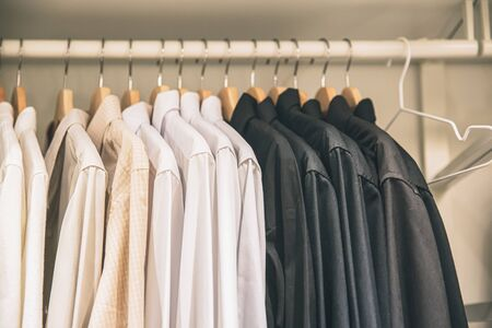 Men Clothes business shirt hanging in the closet neatly vintage color tone. Reklamní fotografie