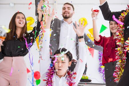 Business office party boss with staff funny enjoy new year celebration events.