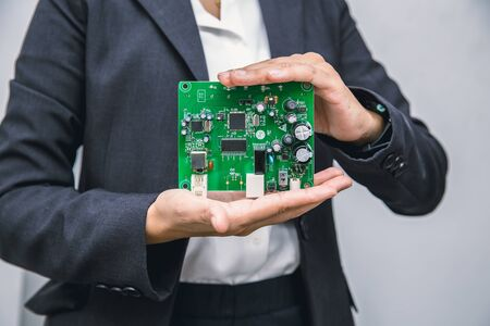 Business people showing printed circuit board new tech computer unit digital device in hand. Reklamní fotografie