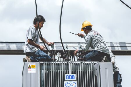 Technician or electricity engineer working setup replace new electricity current transformer size 800kVA for condominium.13 June 2019,Bangkok, Thailand.