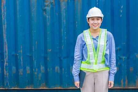 portrait of young woman worker in shipping import export cargo industry with space for text.
