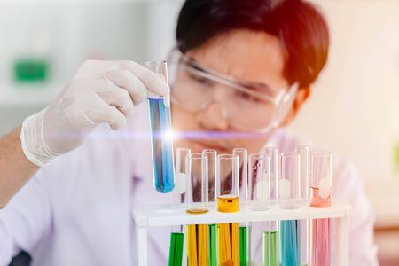 Scientist looking at chemical science test tube successful to discover new drug anti virus vaccine concept
