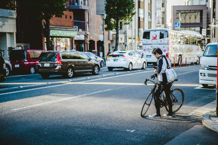 Japan cyclist cycling in the city due to outbreak of the virus Coronavirus(Covid-19) causes people to become more popular with cycling., December 2017, Osaka, JAPAN.