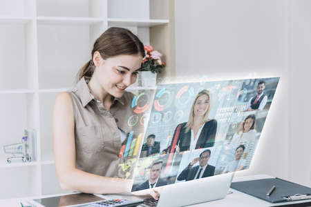 Businesswomen happy using high technology online meeting via internet with futuristic digital device to video calling with business partner around the world in the office concept.
