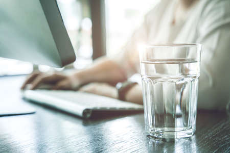 Drink clean room temperature water during working time for healthy and stay hydrated at work. Imagens
