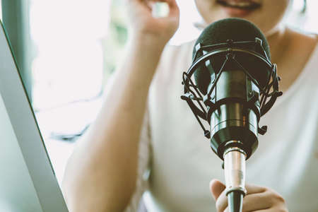People working at home for making internet radio broadcasting channel live streaming talking meeting or discussion closeup condenser microphone.