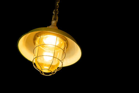 ceiling hanging light lamp isolated on black background