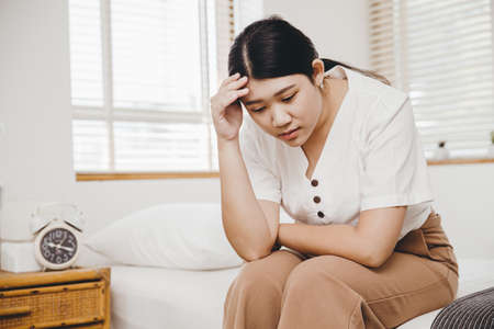 Asian woman feel stress and anxiety fear or panic at home bedroom